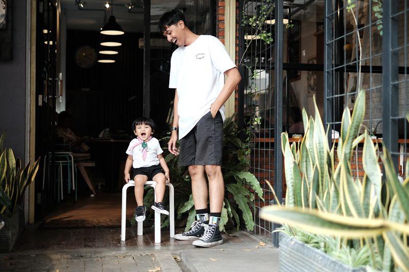 2. White T-shirt & Boardshorts