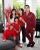 2. Kompak outfit merah saat perayaan imlek